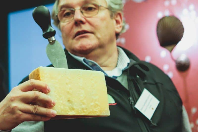 man holding cheese
