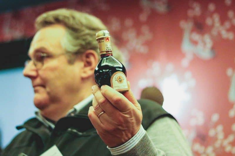 man holding bottle demonstration