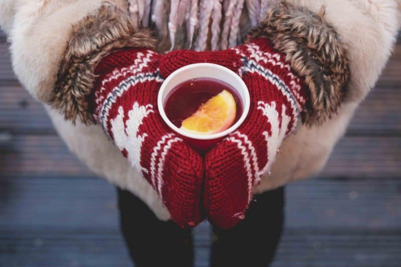 holding mulled drink gloves winter