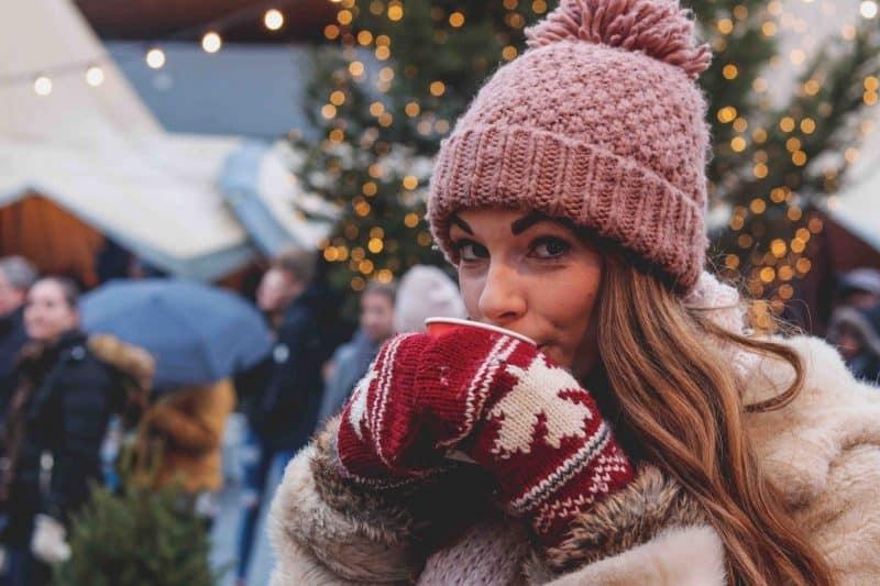 girl drinking mulled wine christmas market